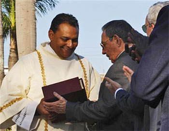 Raul Castro accepting a bible from local Bishop Miguel Angel Ortiz during the ceremony witnessed by 30,000 participants of the beatification on November 29 2008 of Cuban José Olallo, brother of the Order de San Juan de Dios, who looked after the body of Ignacio Agramonte.